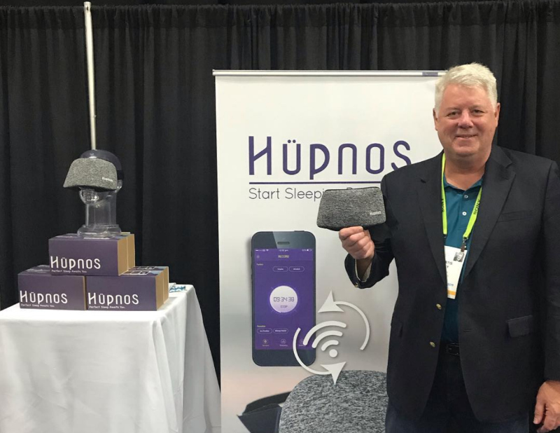 Hupnos founder and CEO Curtis Ray at CES 2019 in Las Vegas, holding the Hupnos Sleep Mask