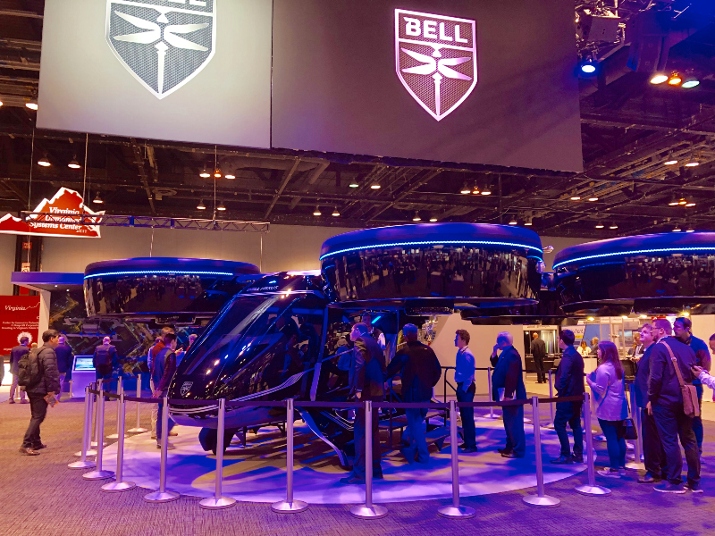 AUVSI XPONENTIAL 2019 attendees look at Bell Helicopter Textron's Bell Nexus air taxi