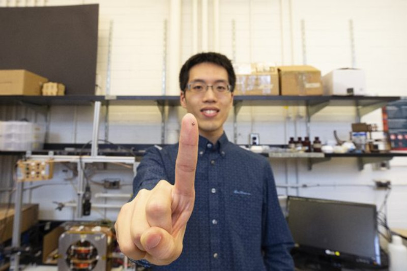 Tianqi Xu holds up a 3D printed magnetized medical robot